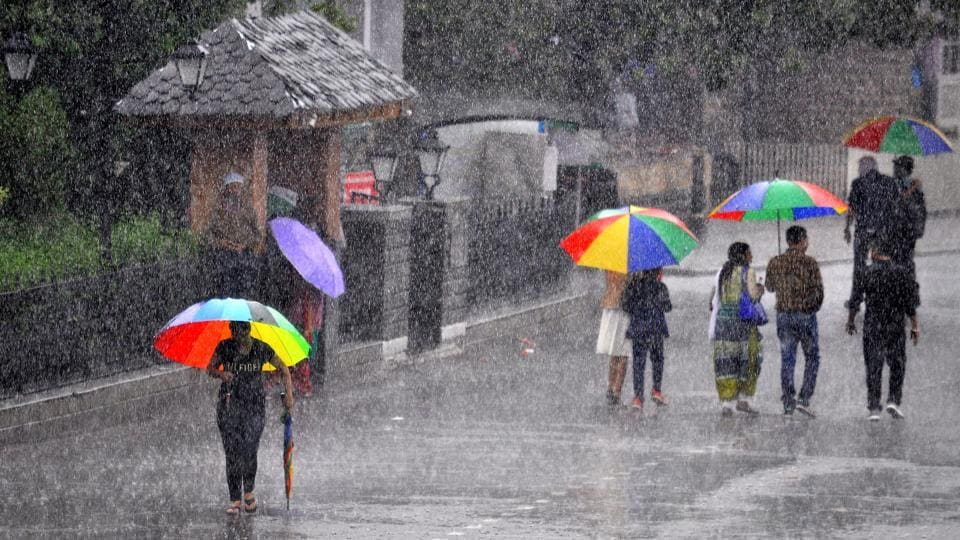 Umbrellas brighten up the damp day as it rains in Shimla on Saturday, June 17. (Deepak Sansta/HT)