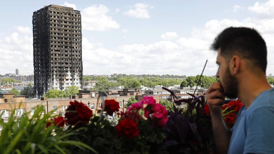 The remains of residential tower block Grenfell Tower are seen from dixon house in west London, a day after it was gutted by fire.  (Tolga AKMEN/AF)
