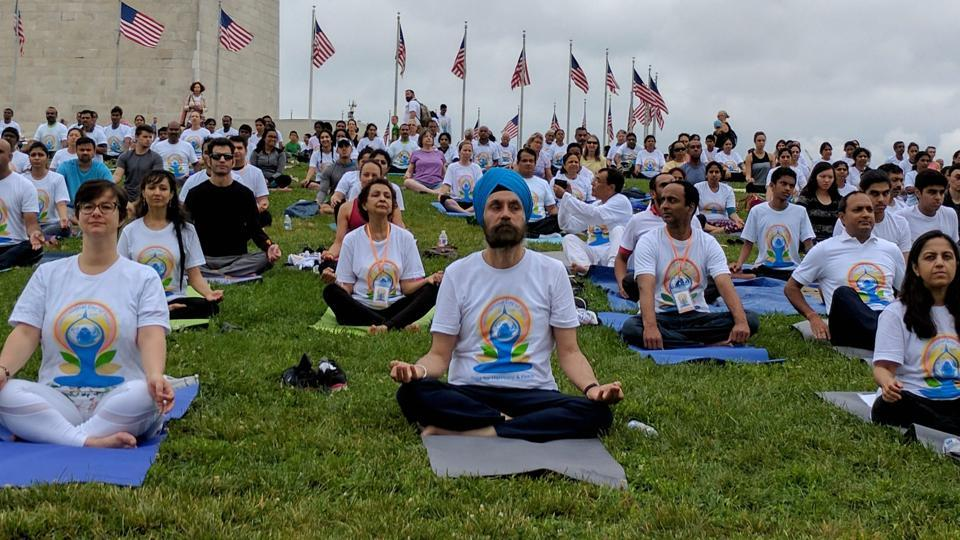 Indian Ambassador to US Navy Sarna joining yoga enthusiasts to celebrate international yoga day at the National Mall in Washington DC on Saturday.