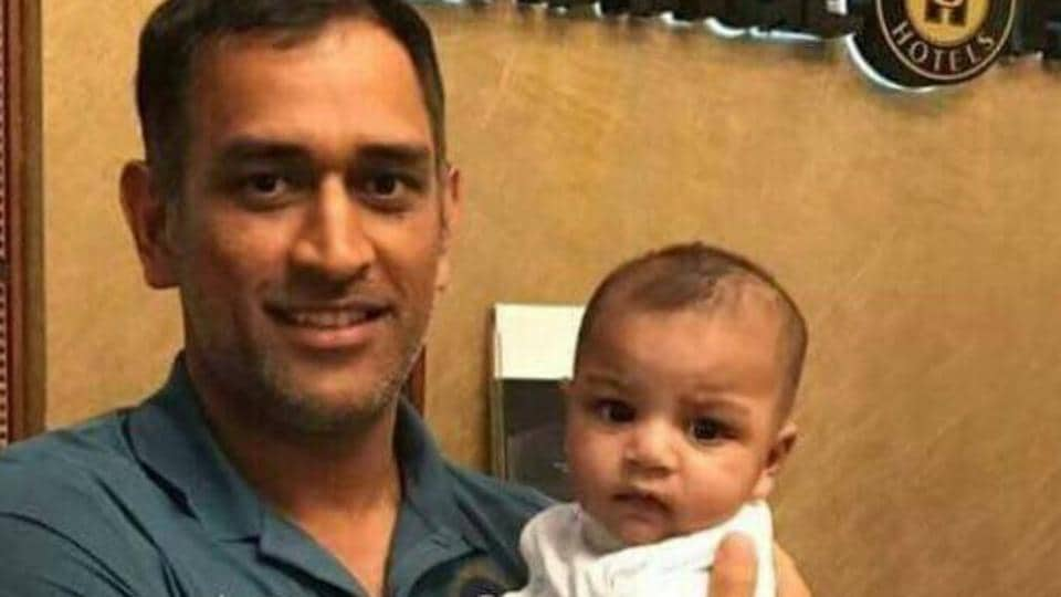 Former Indian cricket team skipper MS Dhoni with Pakistan cricket team skipper Sarfraz Ahmed's son on the eve of the final of the ICC Champions Trophy final between the two sides.