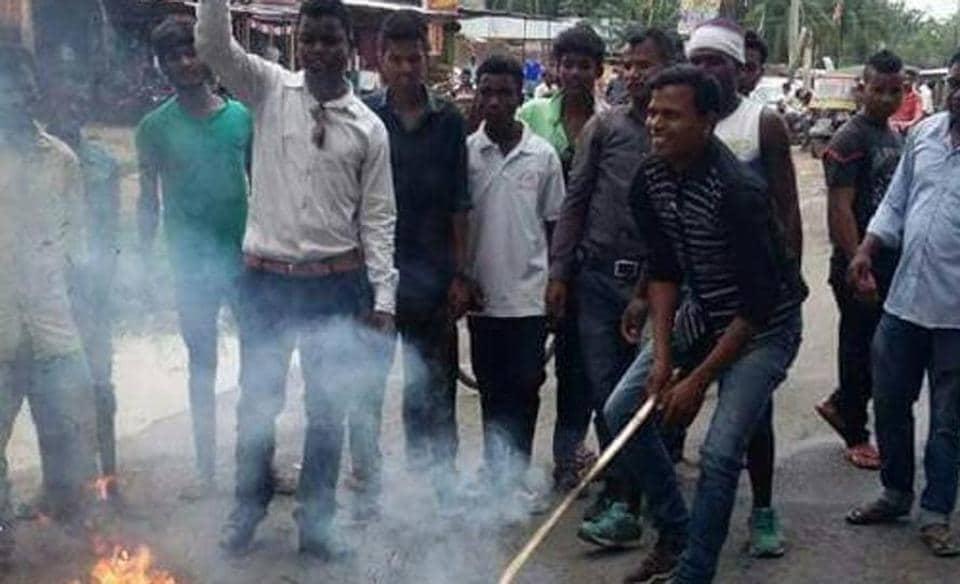 Adivasi protesters burning an effigy of Uttar Pradesh chief minister Yogi Adityanath at Dhekiajuli in Assam on Sunday.