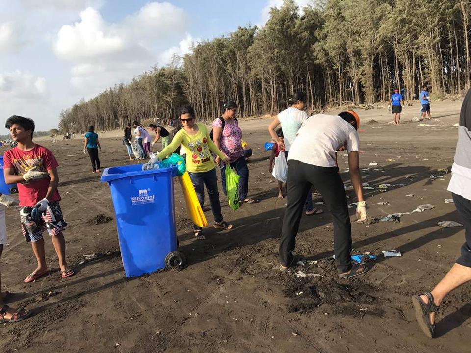 Members of Clean Vasai Beaches collect trash at Bhuigaon beach.