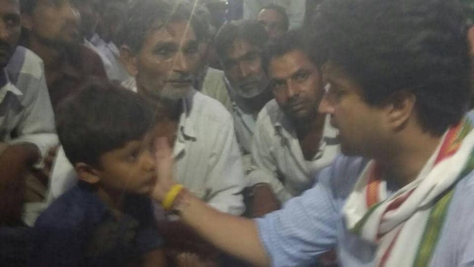 Congress MP Jyotiraditya Scindia consoling Rudra, the seven-year-old son of Ghanshyam Dhakad at Barwan village in Mandsaur of Madhya Pradesh.