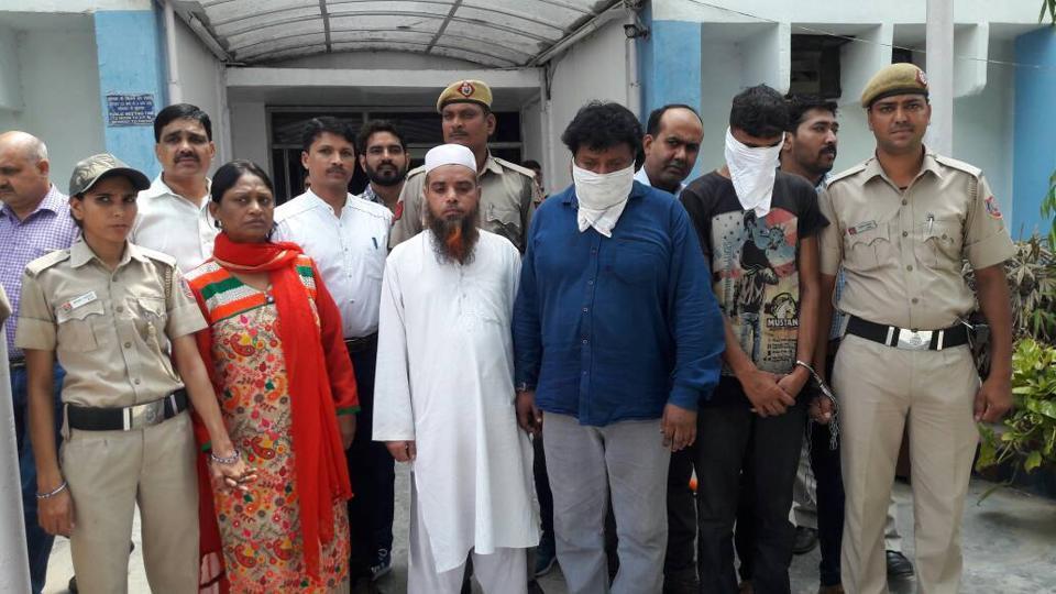 The accused in police custody.