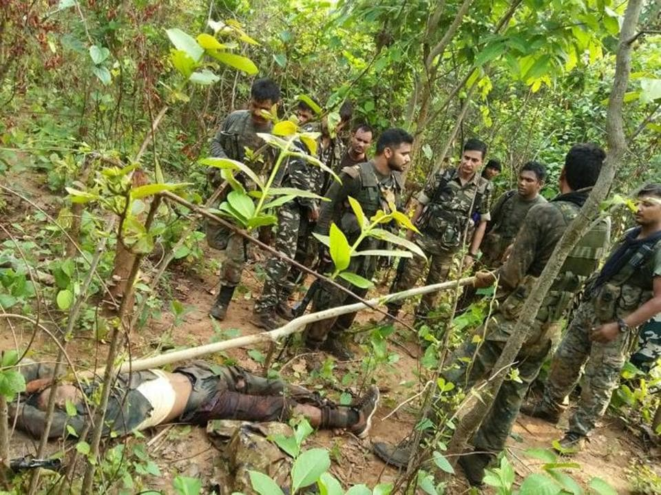 Jawans of the central para military forces with the body of a slain Maoist in the forest of Jamui (Bihar) on Sunday.