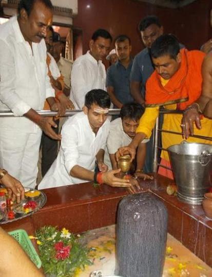 Bihar health minister Tej Pratap Yadav performing 'rudrabhishek' of Lord Shiva at a temple in Sonepur (Bihar).