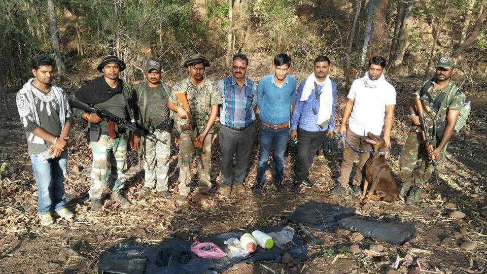 Police with IED seized in the Sitapala jungle, close to the border with Maoist-hit Chhattisgarh.