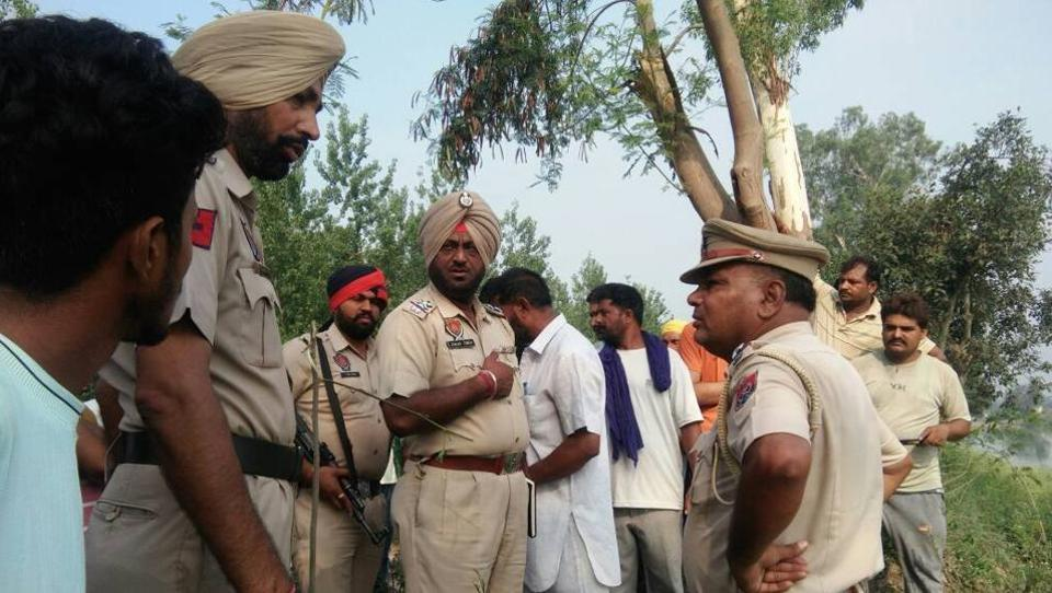 Police officials at Bist-Doab canal in Manewala village near Kathgarh town.