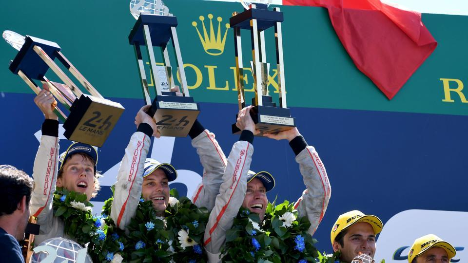 (From L to R) New Zealand's Brendon Hartley andEarl Bamber and Germany's Timo Bernhard celebrate on the podium after winning the 85th Le Mans 24-hours endurance race with their Porsche 919 Hybrid N°2 on Sunday.