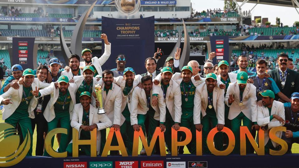 Pakistan cricket team players celebrate with the ICC Champions Trophy, after defeating India in the final.