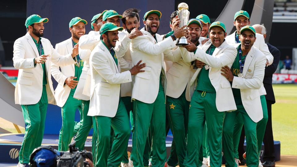 Captain Sarfraz Ahmed (3R) lifts the ICC Champions Trophy as Pakistan players celebrate their win against India in the final at The Oval in London on Sunday.