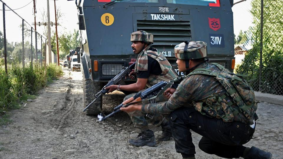Army jawans take positions during an encounter with militants at Arwani village of Anantnag district of South Kashmir on June 16, 2017.