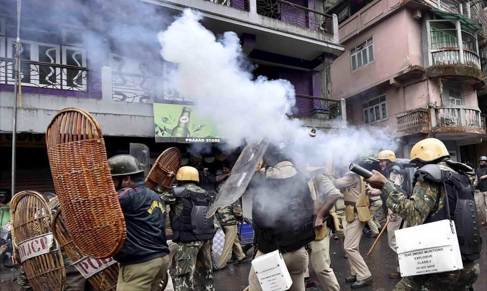 Security personnel fire teargas shells during a protest by GJM activists in Darjeeling on June 17, 2017.