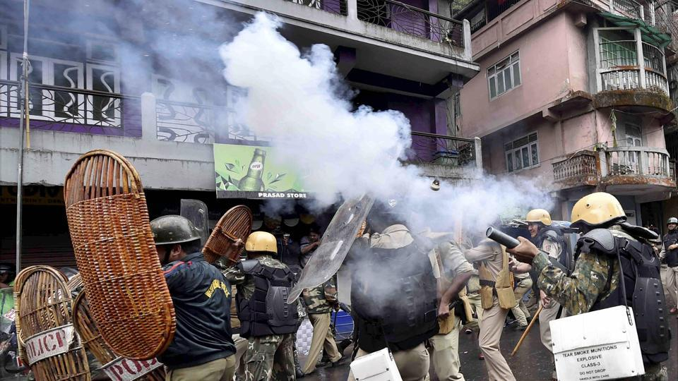 Security personnel fire teargas shells during a protest by GJM activists in Darjeeling on Saturday.