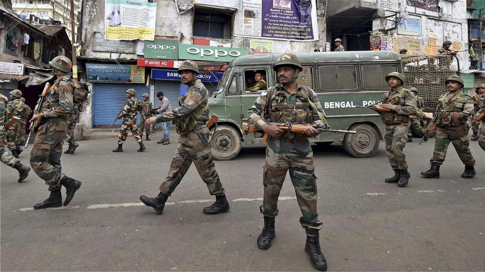 Security personnel patrol a road during a GJM strike in Darjeeling on Saturday.