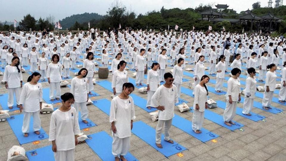 Yoga enthusiasts participate in an event to celebrate 3rd International Day of Yoga in Wenzhou, China on June 18, 2017.