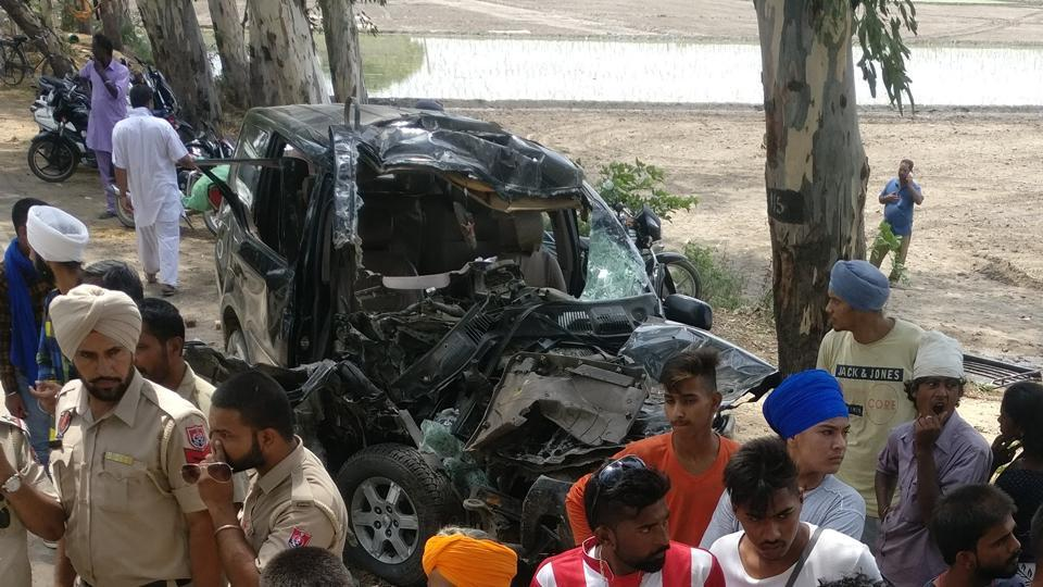Police and locals at the spot of the accident in Rupewal village near Lohian on Sunday.