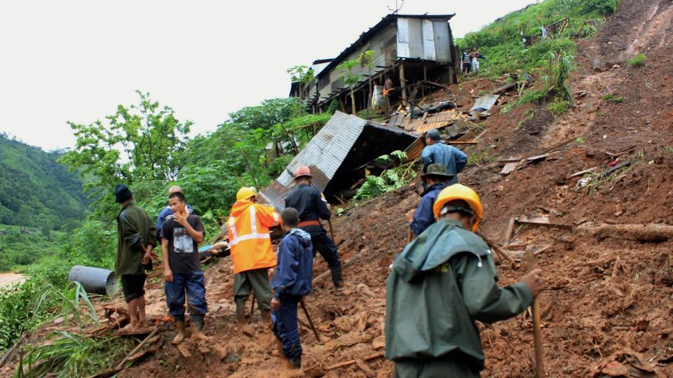 Rescue work in progress after a landslide Tharia village under Umiam Police Station in Meghalaya district due to heavy rains on June 17, 2017.