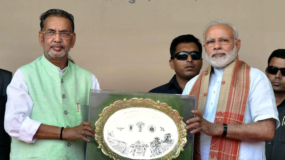 PM Narendra Modi with agriculture minister Radha Mohan Singh at Gogamukh in Assam.