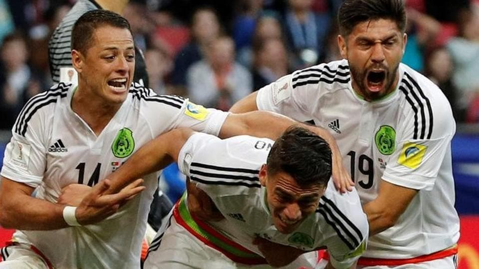 Mexico's Hector Moreno celebrates scoring their second goal with Javier Hernandez and Oribe Peralta against Portugal in the FIFAConfederations Cup.