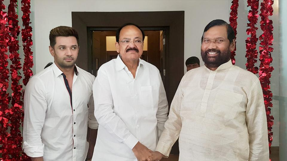 Union Minister and senior BJP leader M Venkaiah Naidu meets LJP President Ramvilas Paswan and his son MP Chirag Paswan in New Delhi on Sunday. BJP leaders are meeting leaders of various political parties to reach a consensus on presidential nominee.