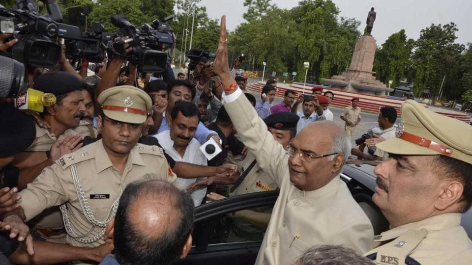 Bihar governor and NDA presidential nominee Ram Nath Kovind waves outside Governor's house in Patna on Monday before leaving for New Delhi.