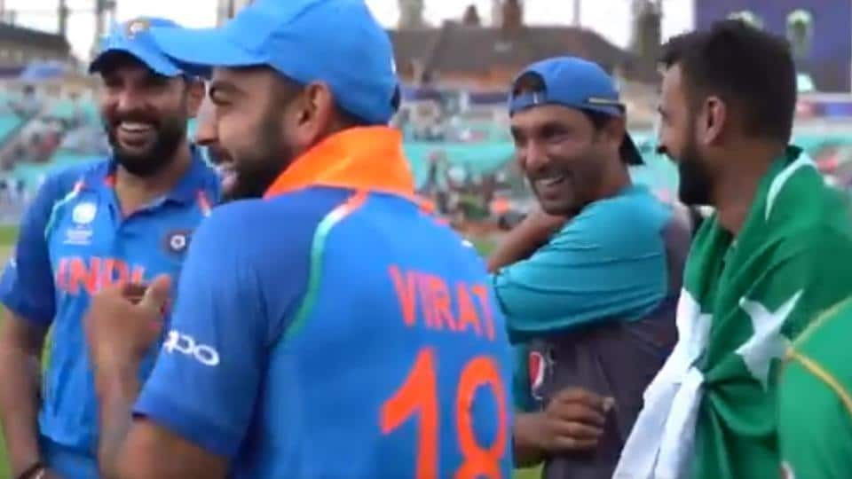 India captain Virat Kohli (2L) and teammate Yuvraj Singh (L) were seen sharing a light moment with Pakistan all-rounder Shoaib Malik (R) and their bowling coach Azhar Mahmood after the ICC Champions Trophy final.