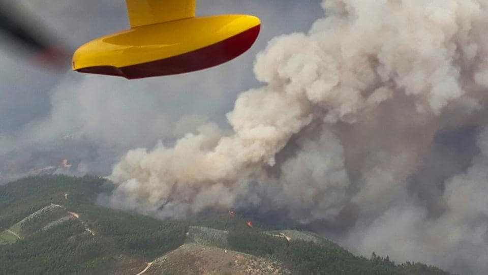 An aerial view of a forest fire is seen from the cabin of a Spanish fire fighting plane. Portugal received help from its European neighbours with four Spanish fire engines  seen driving off from the headquarters. (REUTERS)