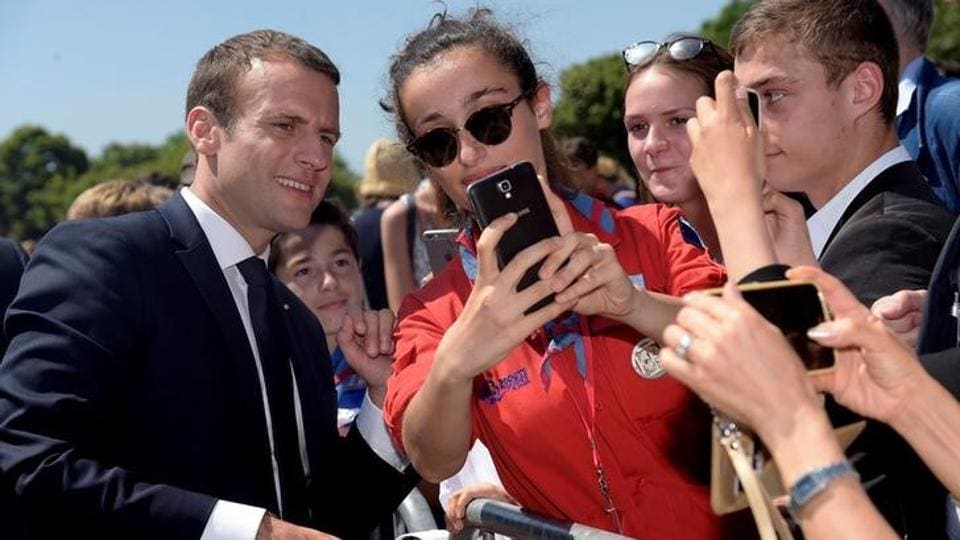 French President Emmanuel Macron (L) attends a ceremony marking the 77th anniversary of late French General Charles de Gaulle's resistance call of June 18, 1940, at the Mont Valerien memorial in Suresnes, near Paris, France, June 18, 2017.