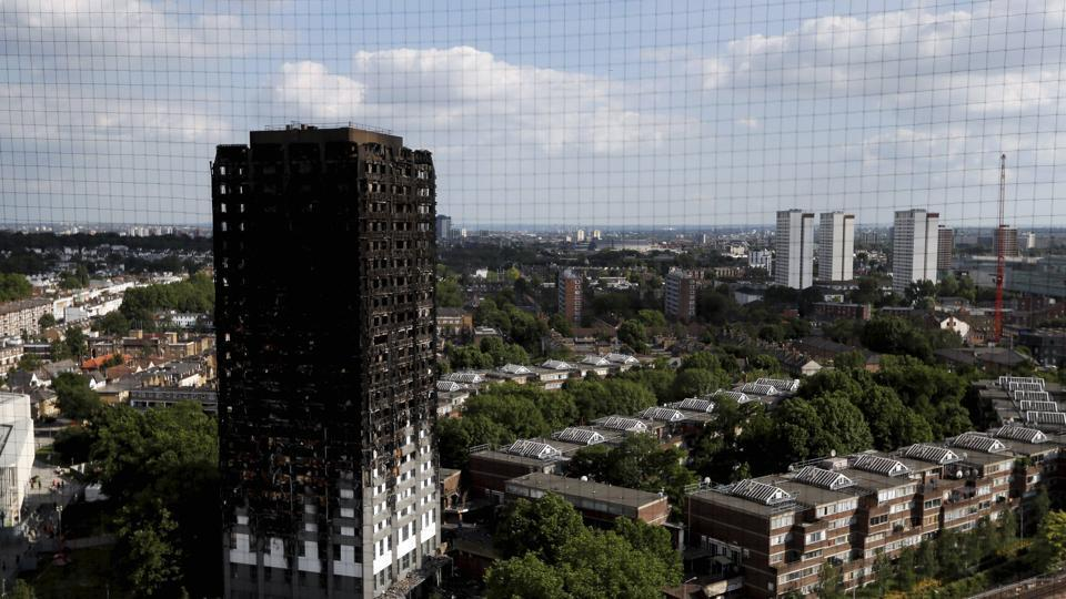 The remains of Grenfell Tower stand in London.