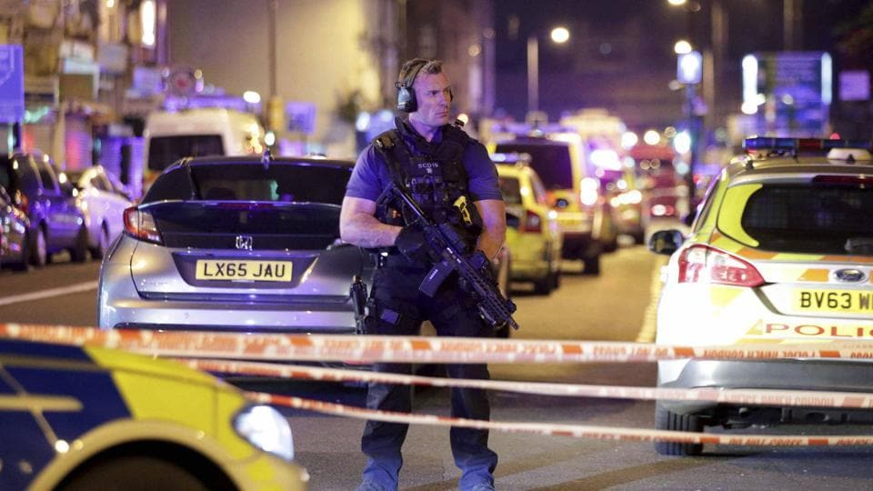 An armed police officer mans a cordon on the Seven Sisters Road at Finsbury Park where a vehicle struck pedestrians in London Monday, June 19, 2017. Police say a vehicle struck pedestrians on the road in north London, leaving several casualties and one person has been arrested.