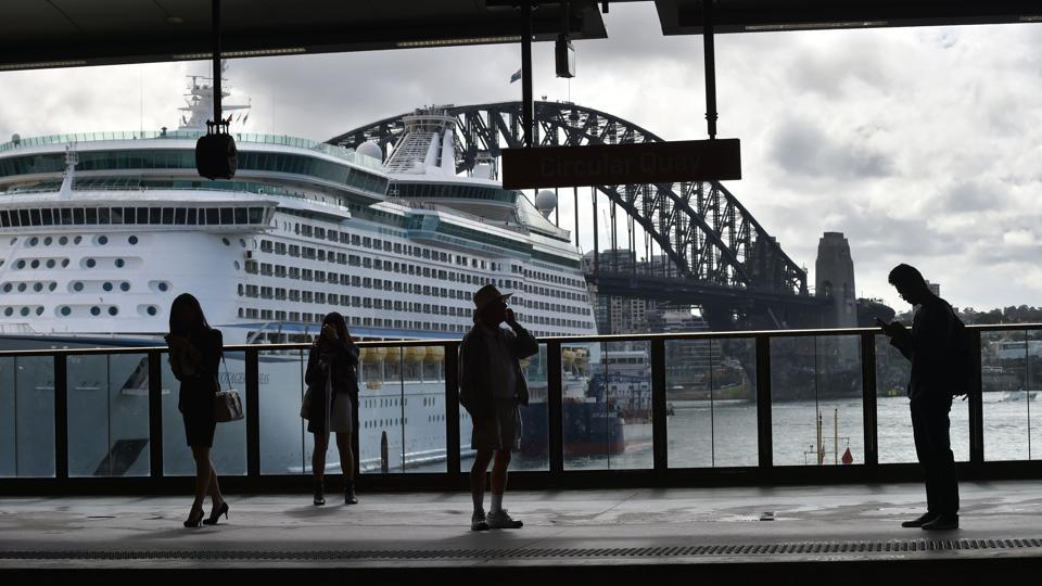 People wait for a train at Circular Quay in Sydney on April 19, 2017. In the first four months of 2017 alone, the Department of Immigration and Border Protection granted more than 65,000 visitor visas to Indian nationals.