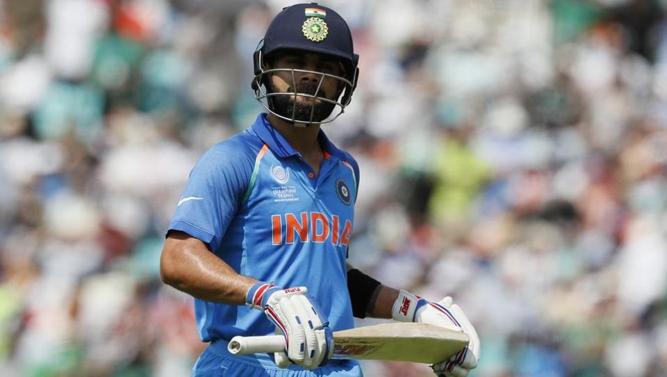 India's Virat Kohli leaves the pitch after being dismissed for five runs during the ICC Champions Trophy final against Pakistan.