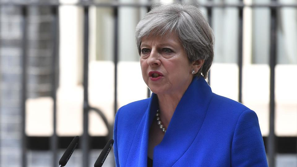 Britain's Prime Minister and leader of the Conservative Party Theresa May outside 10 Downing Street in central London on June 9, 2017.