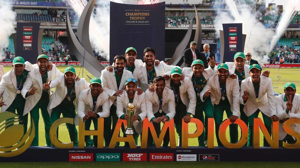 Pakistan players pose with the trophy as they celebrate their win at the presentation after the ICC Champions Trophy final against India at The Oval on Sunday.