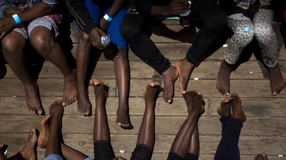 Women on their way to Italy sit on the deck of the rescue vessel Golfo Azzurro, after being rescued by Spanish NGO Proactiva Open Arms workers from the Mediterranean Sea on Friday, June. 16, 2017. (AP)