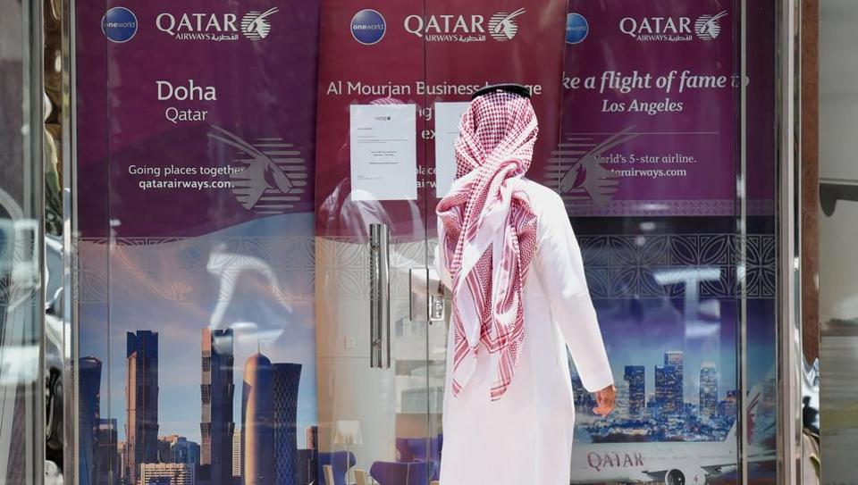 Man standing outside the Qatar Airways branch in the Saudi capital Riyadh, after it had suspended all flights to Saudi Arabia following a severing of relations between major gulf states and gas-rich Qatar.