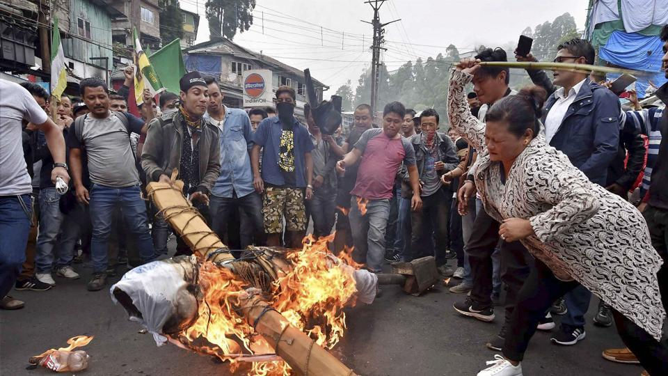 GJM supporters burn an effigy of West Bengal Chief Minister Mamata Banerjee at Chowk Bazaar during their indefinite bandh in Darjeeling on Monday.