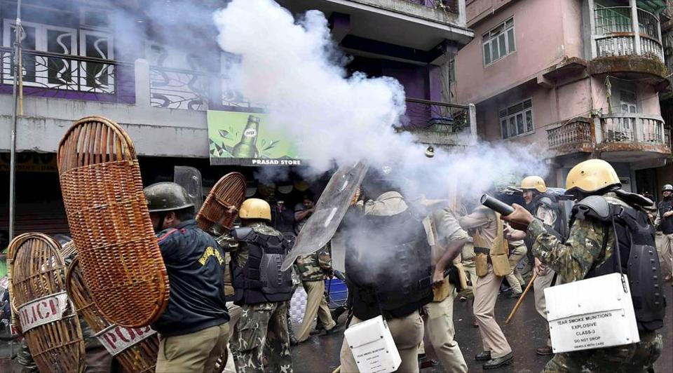 Security personnel fire teargas shells during a protest by GJM activists in Darjeeling.