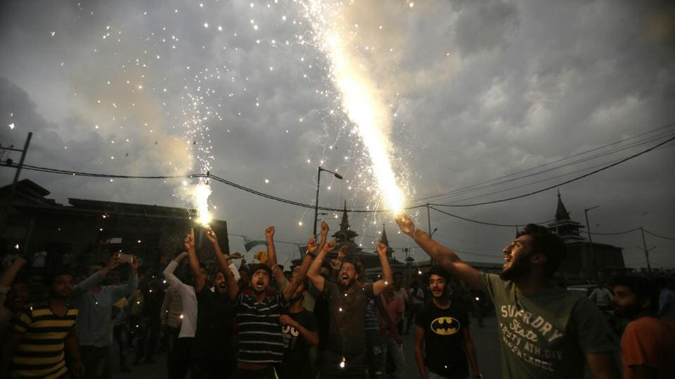 Kashmiris light firecrackers in Srinagar as they celebrate India losing two early wickets during the Champions Trophy final match on Sunday.