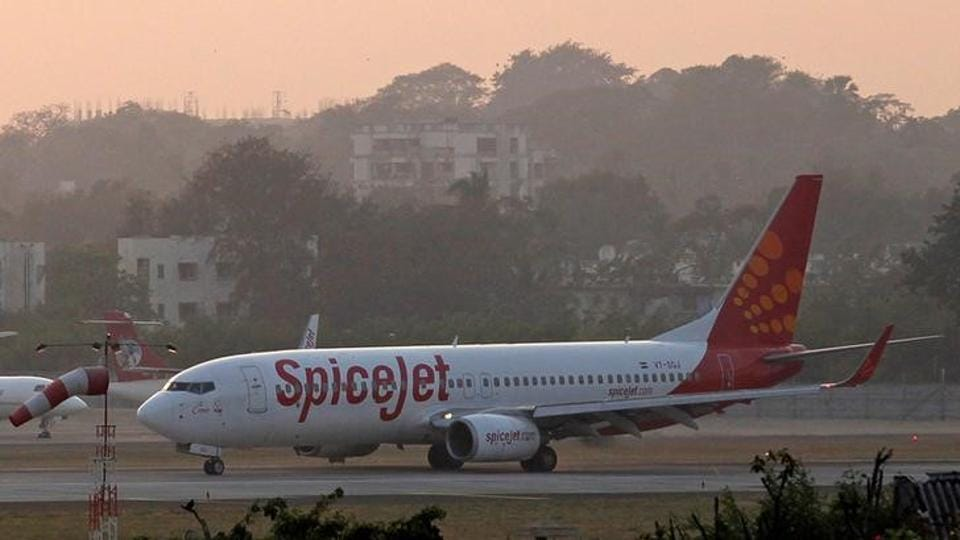 A SpiceJet Boeing 737-800 aircraft taxis on the tarmac after landing at Chhatrapati Shivaji international airport in Mumbai.