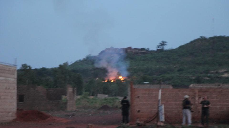 Fire can be seen by the swimming pool of the Campement Kangaba, a tourist resort near Bamako, Mali.