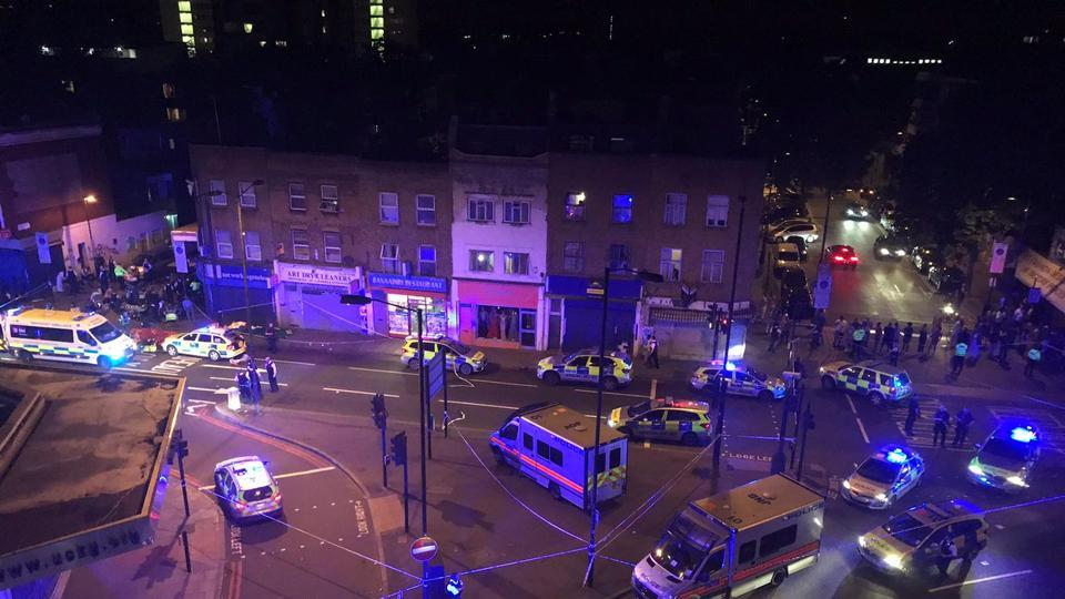 An overview of the street scene surrounded by Police cars and ambulances after a vehicle collided with pedestrians in the Finsbury Park neighborhood of North London, Britain June 19, 2017. Prime Minister Theresa May said police were treating the van incident  'as terrible and a potential terrorist attack'. (REUTERS)