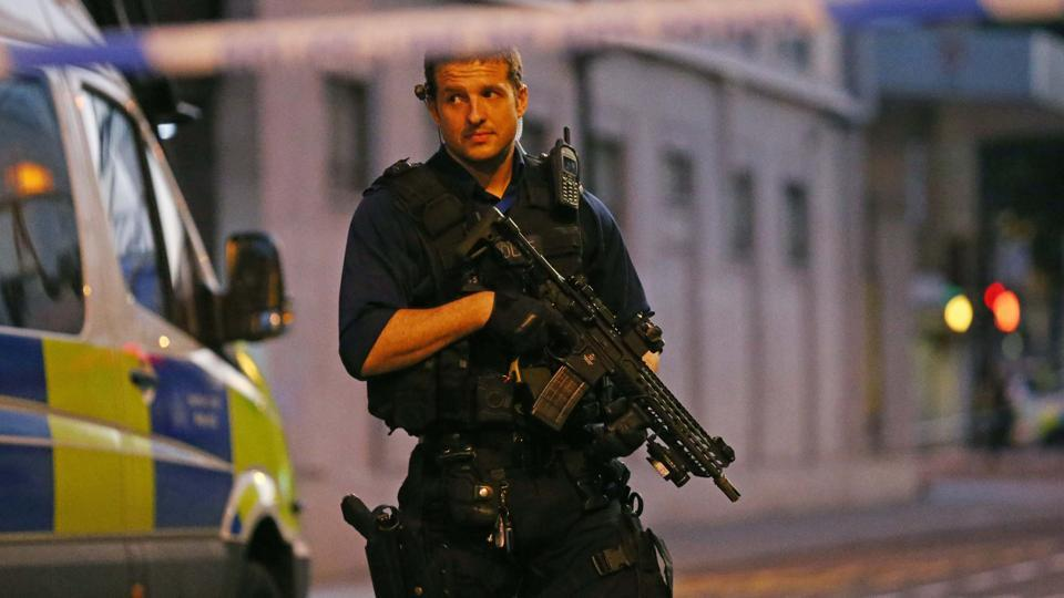 An armed police officer stands behind a cordon at the scene of the suspected attack at Finsbury Park neighborhood. Scotland Yard said that the investigation is being carried out by Counter Terrorism Command and  more officers deployed to reassure Muslims during the holy month of Ramadan. (REUTERS)