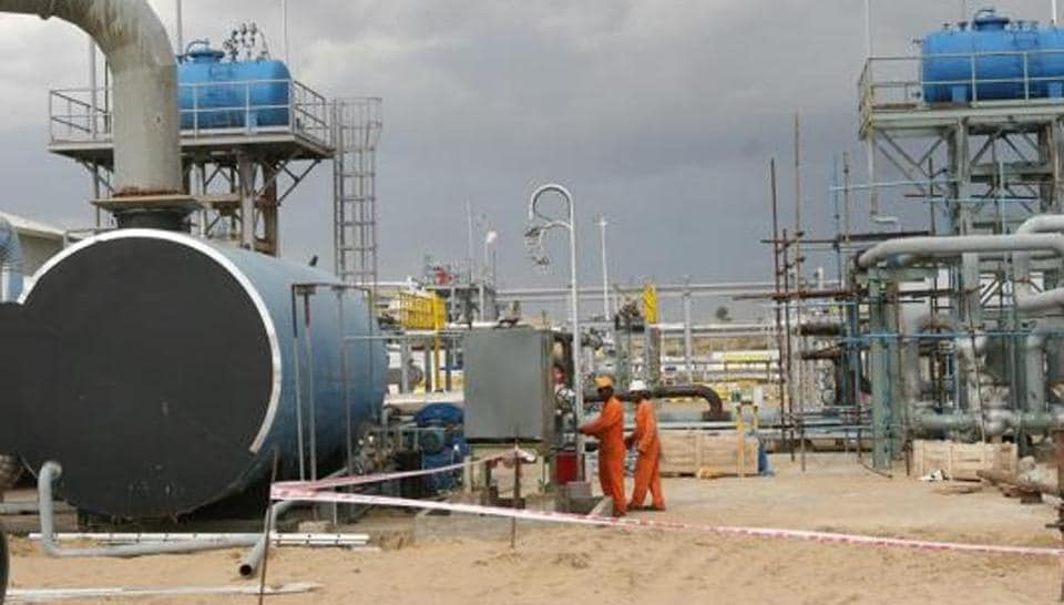 File photo of Cairn India (now Vedanta)employees work at a storage facility for crude oil at Mangala oil field at Barmer in the desert Indian state of Rajasthan.
