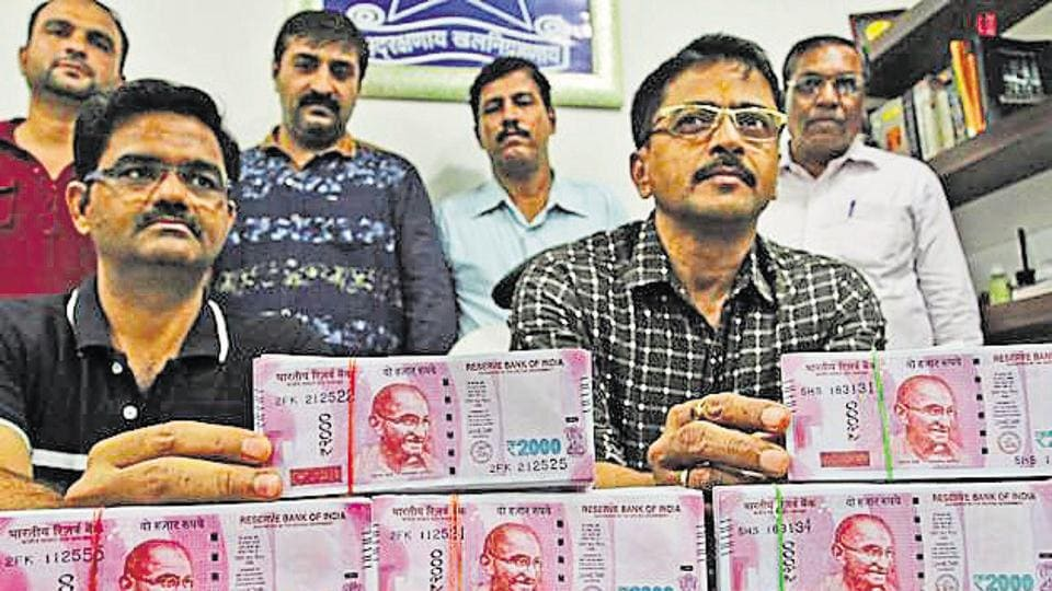 Police show the seized fake currency.