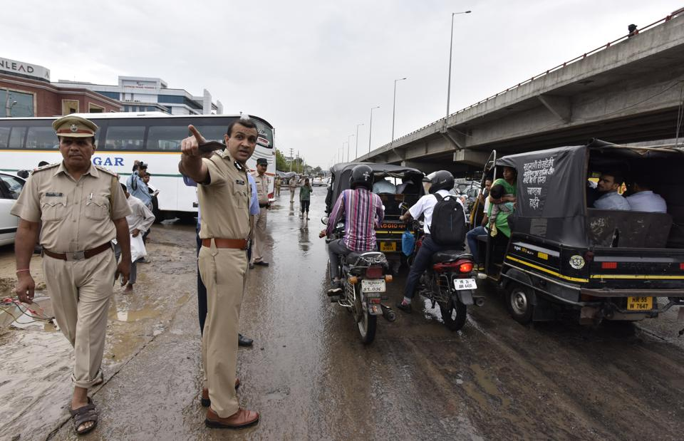 Gurgaon police commissioner Sandeep Khirwar directs traffic at Hero Honda Chowk on Monday.