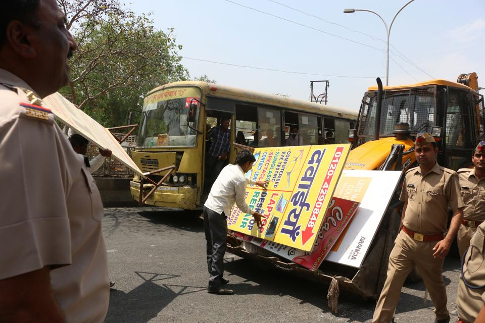 Temporary encroachments such as illegal shops and stalls are removed by the police during drives.