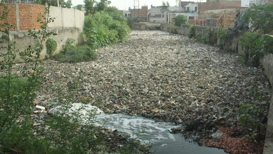 LMC sued for its failure to clean silt from nullahs.