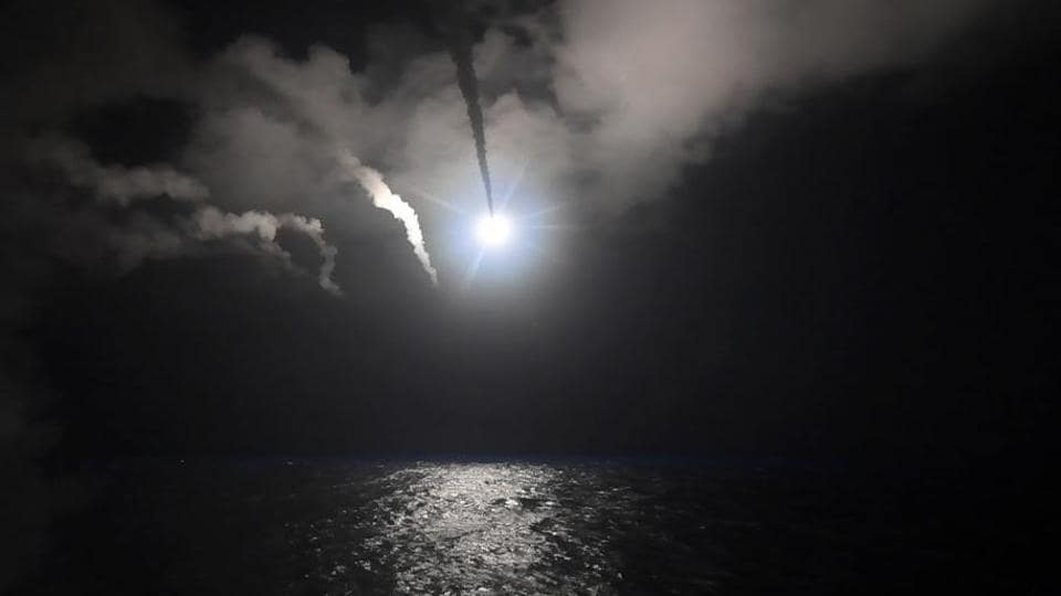 In this file image provided on April 7, 2017 by the US Navy, the guided-missile destroyer USS Porter (DDG 78) launches a tomahawk land attack missile in the Mediterranean Sea. The US missile attack has caused heavy damage to one of Syria's biggest and most strategic air bases.